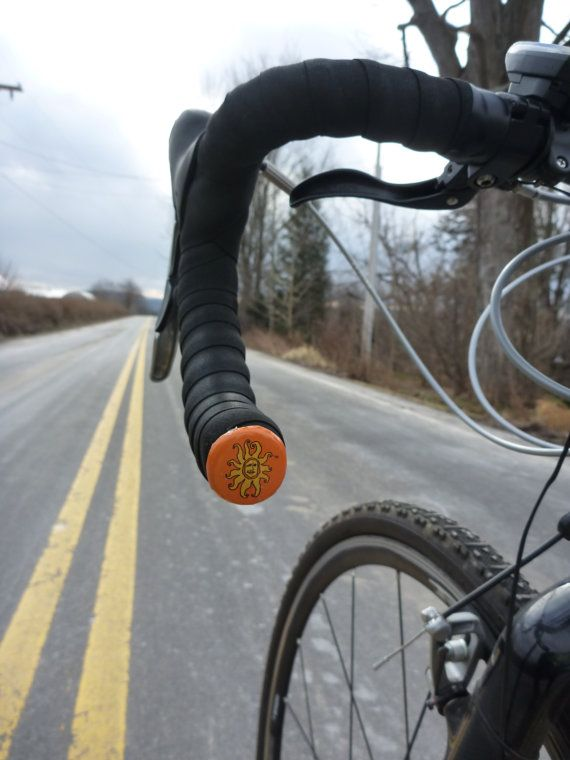 Recycled Handlebar Beer Caps.  I could use a beer every time mine fall off!