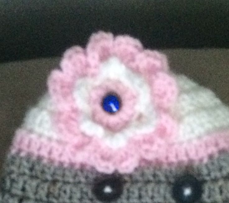 Close-up of flower on girl monkey hat. It's crocheted.