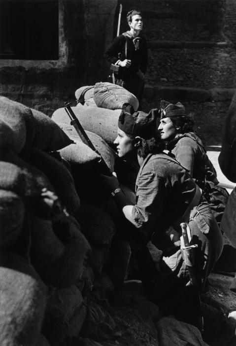 Barcelona, Catalonia. Spain. Militiawomen defending a street barricade. By Robert Capa, (August 1936)