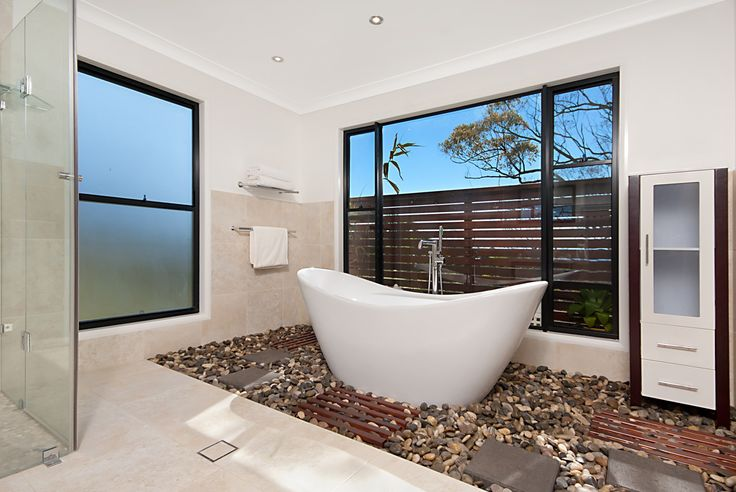 free standing bath with river stone floor - Redwood Grove #delcasahomes