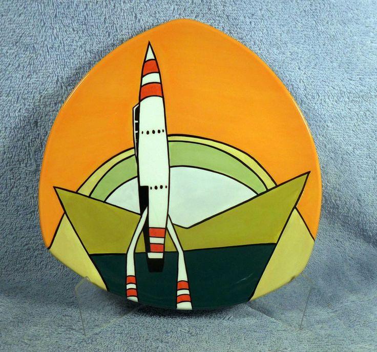 2005 DISNEYLAND TOMORROWLAND Rocket to the Moon Dessert Plate, MIB, found at http://stores.ebay.com/Disneyland-Treasures