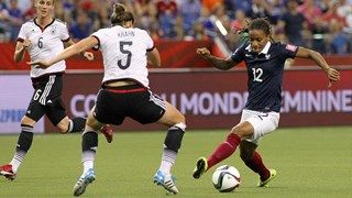 Elodie Thomis #12 of France controls the ball past Annike Krahn #5 of Germany