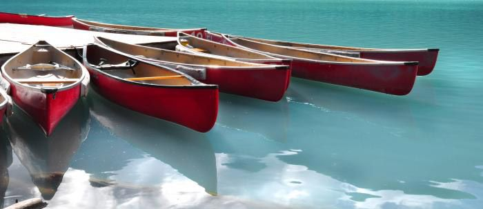Red Canoes at Lake Louise, a classic stunning visual. by Marcus Z at www.planetartgallery.ca