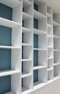 Wooden bookcase,  in white lacqured birch plywood with custom coloured back, bespoke,   made in   Norway by Designermade.
