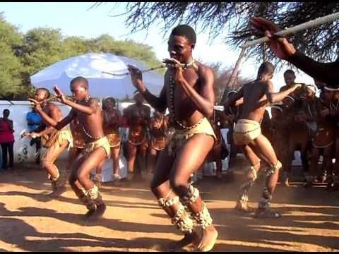 Video. Country: Botswana. A team of young local dancers entertain the crowd with an exciting piece of traditional Tswana dance during a wedding inTlokweng.