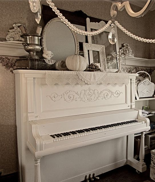 Here's the beautiful piano again.  Hope that it was kept TUNED & PLAYED through the years!  Otherwise, it's just a lovely piece of furniture.