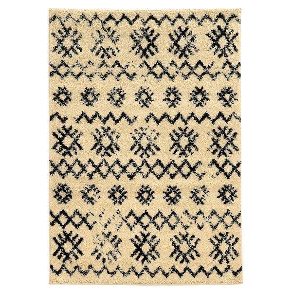 Weathered geometric details and a 2-tone pallet give this eye-catching rug a bold look that elevates any space. Use it to anchor a boho living room ensemble or to define space in the den.