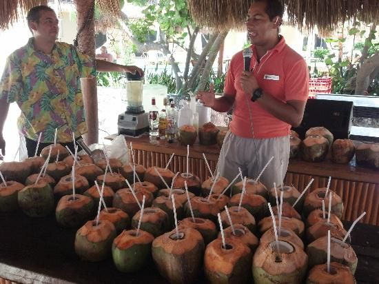 Excellence Riviera Cancun: Making Coco Locos on the beach