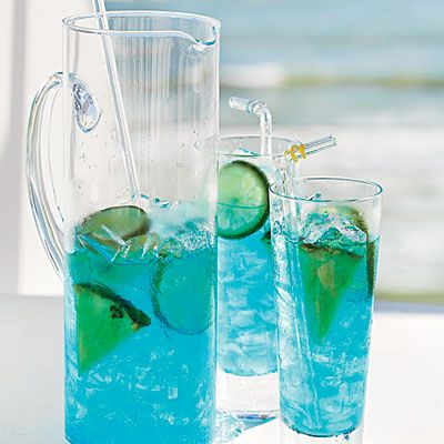Coastal Skies Cocktails. Ingredients: 1 cup  pineapple-flavored vodka or rum,   1 cup  blue Curaçao,   1/2 cup  amaretto liqueur,  1/2 cup  pineapple juice,  1/2 cup  fresh lime juice,   1/4 cup Sweet and Sour Mix or    Simple Syrup,     Garnishes: lime slices, pineapple wedges