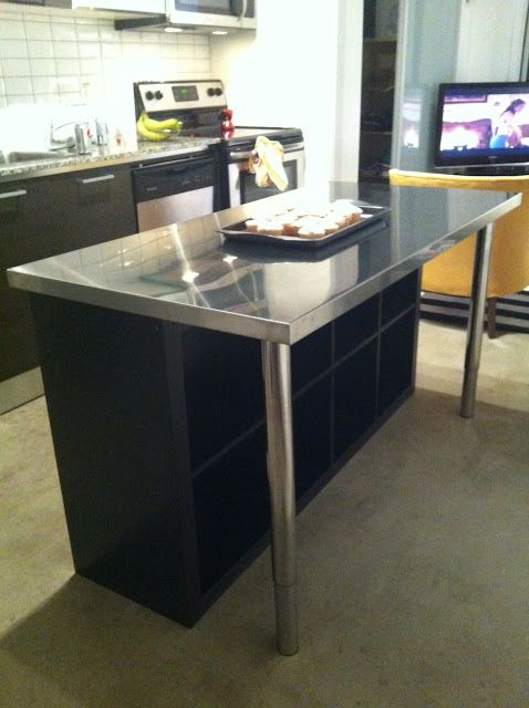 Ikea Expedit unit, a stainless steel counte top, and legs are combined to make an island.