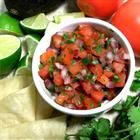 Pico de Gallo Recipe. Ingredients: 6 roma (plum) tomatoes, diced, 1/2 red onion, minced, 3 tablespoons chopped fresh cilantro, 1/2 jalapeno pepper, seeded and minced, 1/2 lime, juiced  1 clove garlic, minced, 1 pinch garlic powder, 1 pinch ground cumin  salt and ground black pepper to taste. Directions: Stir the tomatoes, onion, cilantro, jalapeno pepper, lime juice, garlic, garlic powder, cumin, salt, and pepper together in a bowl. Refrigerate at least 3 hours before serving.