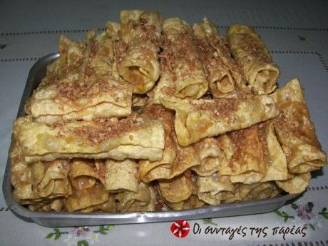 Diples _ Description  Diples are considered a traditional sweet in Kalamata. It is dough rolled into thin strips, fried in olive oil and then dipped in syrup. We gine them at engagements, weddings, christenings. They are delicious.