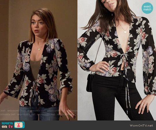 Haley's floral tie-front blouse on Modern Family.  Outfit Details: http://wornontv.net/54159/ #ModernFamily