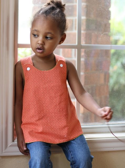 Just adore this sweet pinafore. Crossover back, reversible. Click on tutorial for pattern and instructions.