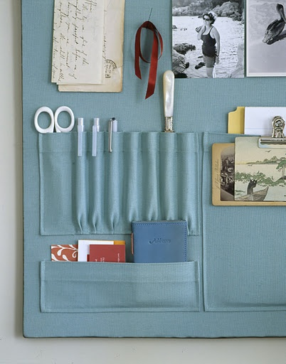 pockets sewn onto fabric that covers the pin board