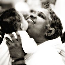 "Mata Amritanandamayi. This woman is known as the ""hugging saint"". She spends all day hugging people. I don't know about you, but a good long hug goes a long way in my book. And sometimes I think it would be so wonderful and a complete blessing to have a job, hugging people."