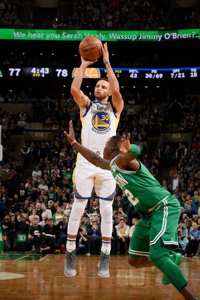 Stephen Curry of the Golden State Warriors shoots the ball against the Boston Celtics on November 16 2017 at the TD Garden in Boston Massachusetts...