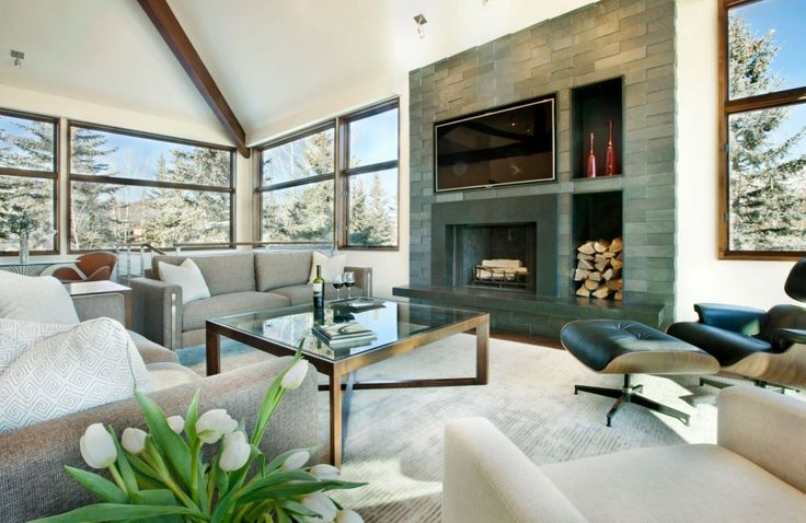 This elegant neutral living room with stunning mountain views was completed by Anne Grice Interiors. #luxeCO