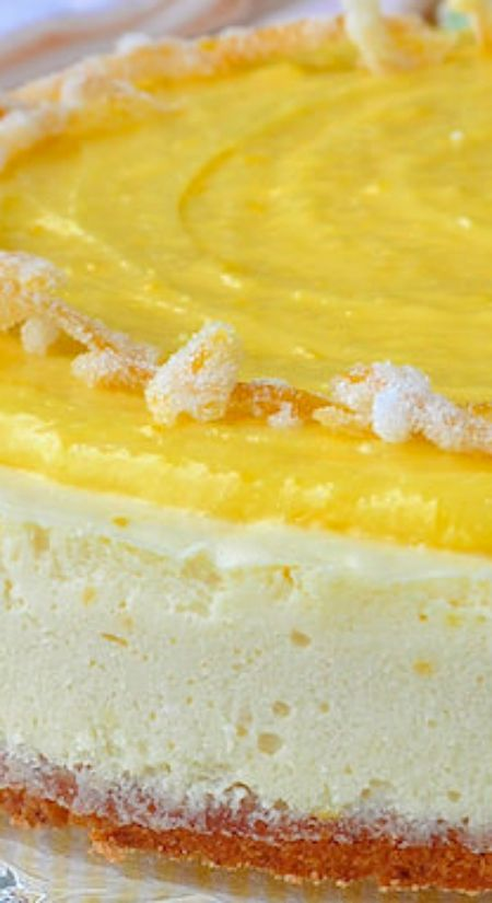 Ultimate Lemon Cheesecake ~ A lemon cookie base, lemon mousse cheesecake body, lemon curd topping and garnish of candied lemon peel... It will satisfy any lemon lover out there.