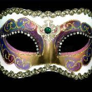 Venetian masks, found in many costuming stores, are beautiful but often very expensive. A cheaper alternative is to make your own mask by purchasing a plain white mask and decorating it yourself. By decorating your own mask, you can make a mask that will go perfectly with your costume and costs only a fraction of the price of ones found in stores.