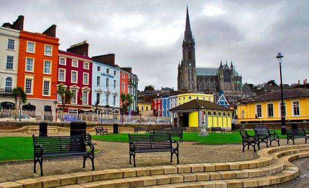 Painted houses and a cathedral, Cobh, County Cork, Ireland.