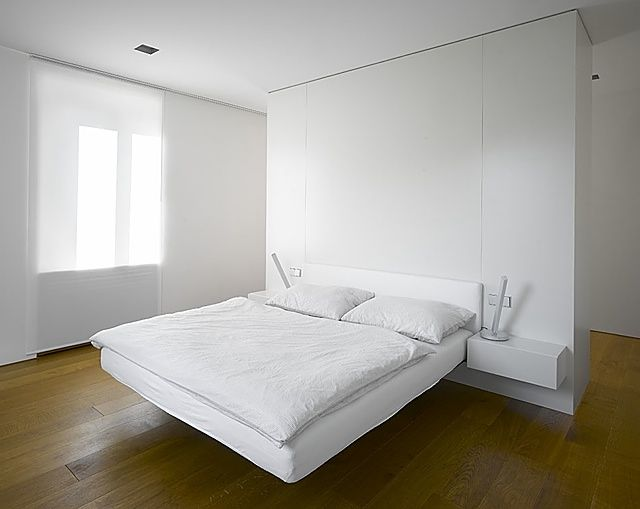 House in Malá Lhota, Czech Republic by Jarousek Rochová Architekti - Love the simplicity of this bedroom furniture. Wardrobes behind bed = WANT