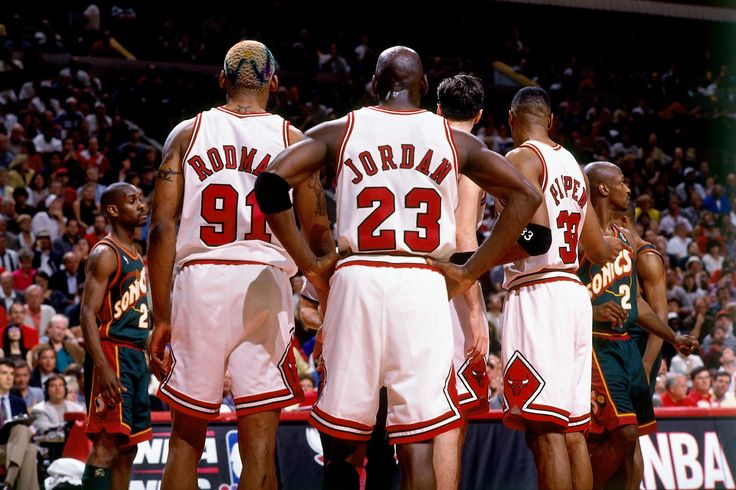 Dennis Rodman, Michael Jordan and Scottie Pippen huddle after a play during the 1996 NBA Finals against the Seattle Supersonics. #SeeRed #TBT