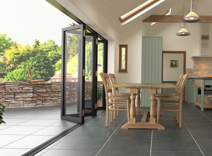 Valverdi Indoor-Out porcelain tiles look great when used with bifold doors to create a seamless link between inside and out!