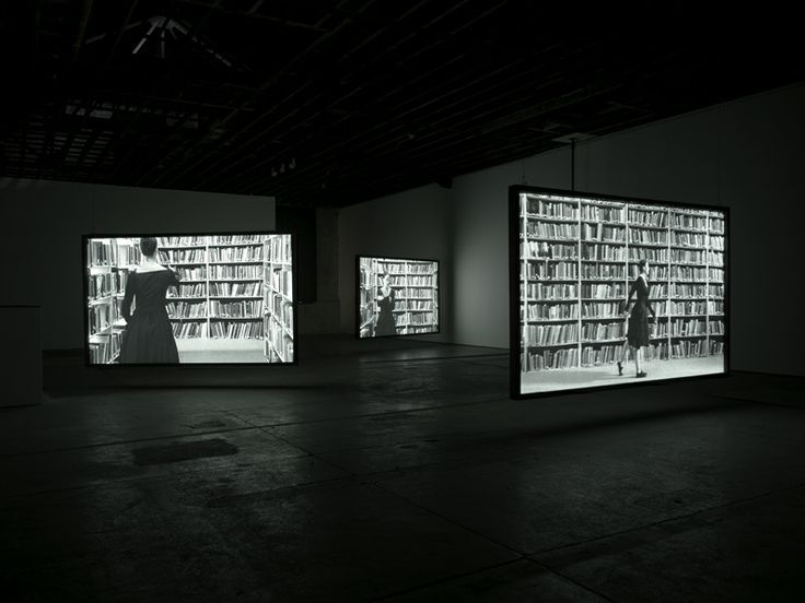 """Idris Khan, production still from """"Lying in Wait"""" (2009). Film installation. Courtesy Victoria Miro Gallery, London - Bookcase construction and scenic elements of this project by Square One - www.squareone.uk.com."""