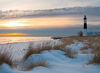 Big Sabel Point, Ludington State Park, Michigan. At the end of a mile and a half foot trail through the Ludington dunes, you will find a tower and attached keeper's dwelling open to the public. Climb to the top of the112 foot lighthouse.