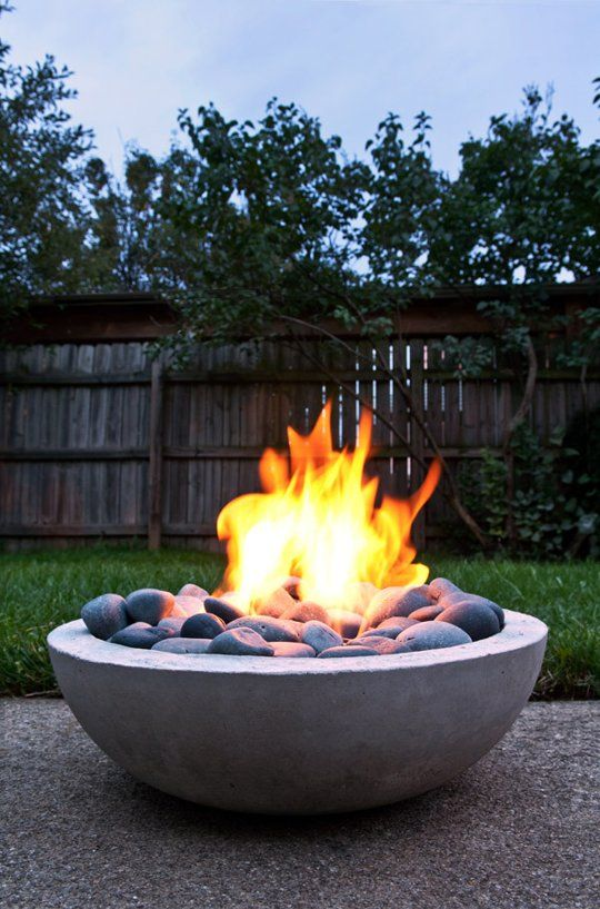Try making your own gas flame pit. This modern design is sleek, sturdy, weatherproof, and takes just a few hours of craftiness with a concrete mold. The DIY blog ManMade takes you through the steps to build your own fire pit with . While the flames aren't exactly bonfire-sized, they're perfect for two people. Or you can make a few of these to put around your yard.