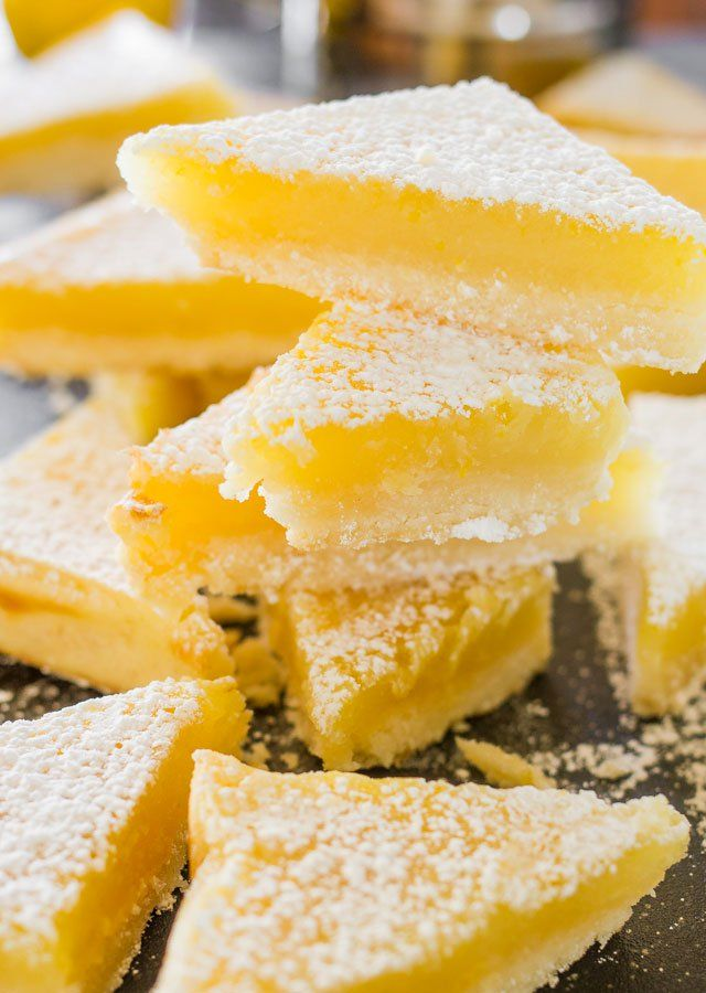 Lemon Bars - A classic recipe with a shortbread crust and a tart and lemony curd filling. These lemon bars are luscious and scrumptious.