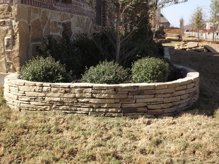 Flower bed edging flower beds and stacked stones on pinterest - Stone edging for garden beds ...