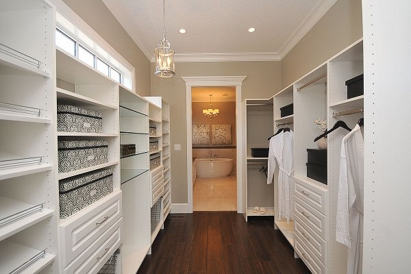 A Custom Built Walk In Closet With Glass Shelves, Shoe Shelves And LOTS Of  Storage