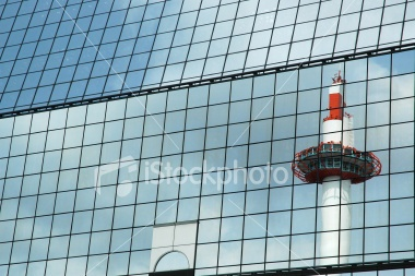 Kyoto Tower is reflected off of Kyoto Station