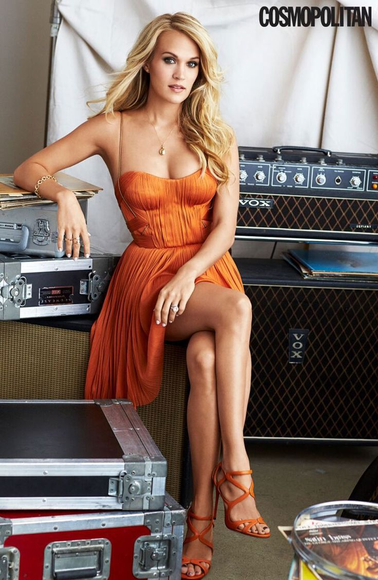 Country music star Carrie Underwood graces the December 2015 cover of Cosmopolitan Magazine wearing a mini dress featuring plenty of sequins and floral embellishments. Matt Jones captured the singer for the magazine, where in another image, she flaunts some leg in an orange and pleated frock with matching sandals. Related: Carrie Underwood's 'Storyteller' Album Artwork Revealed …