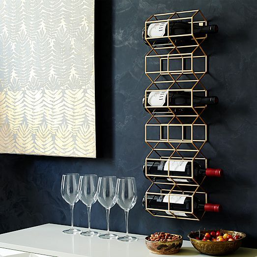 Bottle service. Put your favorite vintages on display with the Deco Wine Bottle Rack. In a brass finish, it stores up to six bottles.