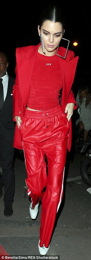 Red hot: The Keeping Up With The Kardashians beauty mixed and matched her styles for a casual vibe, teaming red leather tracksuit pants with a smart coat