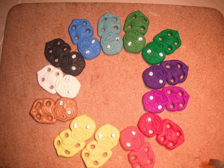 Custom Hei Tiki Brooches made of polymer clay