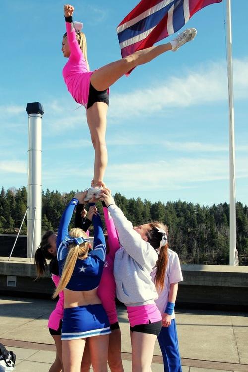 Cheerleading stunts arabesque