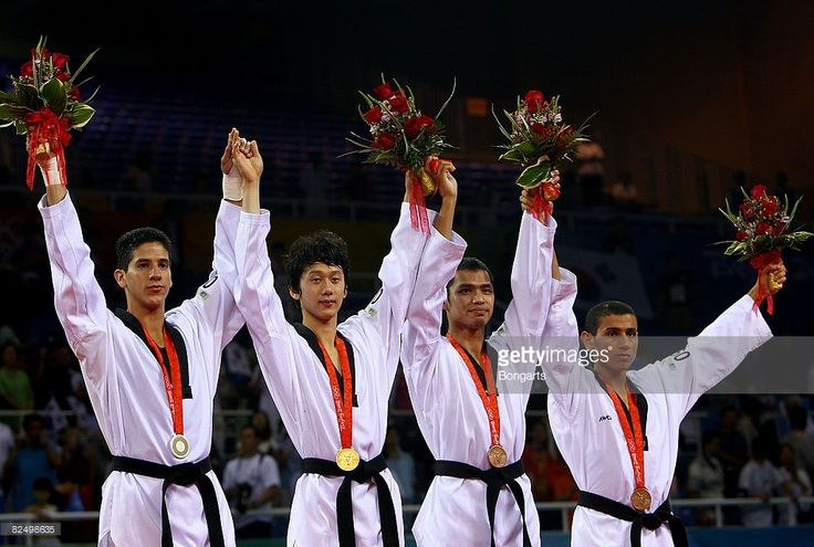 Silver medalist Mark Lopez of the United States, gold medalist Son Taejin of South Korea and bronze medalists Sung Yu-Chi of Chinese Taipei and Servet Tazegul of Turkey pose after the medal ceremony of the Men -68kg Taekwondo contest at the Beijing Science and Technology University Gymnasium during Day 13 of the Beijing 2008 Olympic Games on August 21, 2008 in Beijing, China.