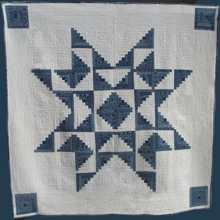 Love the quilting detail in the white.  Hand-Quilted Quilt, Indigo fabric log cabin star. Offered by Sharon Sterns via Etsy.