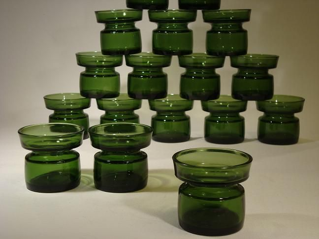Dansk Designs Ltd by Jens H Quistgaard. 1960-1970s.Candle holders in green molded glass