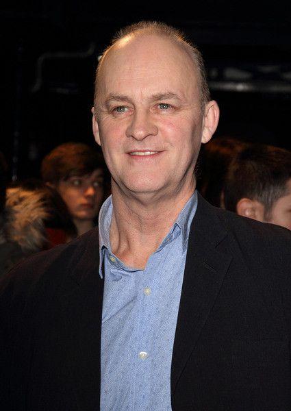Tim McInnerny as Father Bain