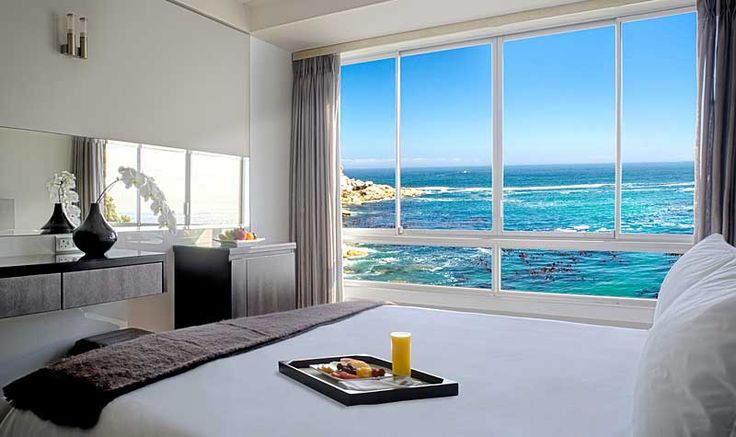 A bedroom with a magnificent view! Ambassador Hotel in Cape Town.