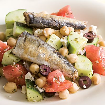 The fresh, tangy elements of a Greek salad — tomato, cucumber, feta, olives, and lemony vinaigrette — pair well with rich-tasting sardines. And it all comes together in just 20 minutes for this easy salad. Serve with warm pita bread and a cold beer for a full meal. Recipe: Greek Salad with Sardines for Two   - Delish.com