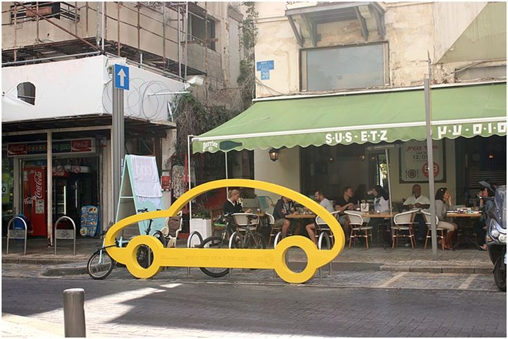 This is cool! A stand for bikes in a form of a car in Shenkin street