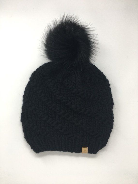 e0f79195e99 Chunky black knit winter hat in spiral pattern with giant faux fur pom pom