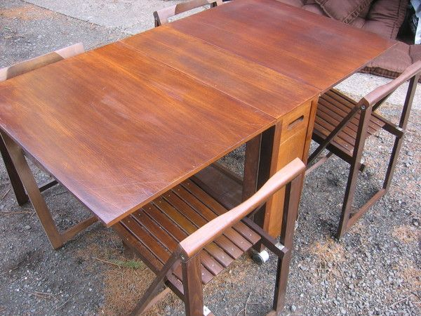 Skinny drop leaf dining table w 4 hideaway wood c for Wood dining sets with leaf