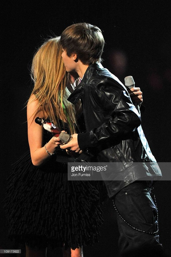 Justin Bieber accepts the International Breakthrough Act award from Avril Lavigne on stage at the The BRIT Awards 2011 at O2 Arena on February 15, 2011 in London, England.